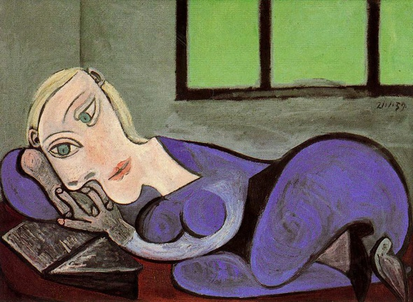 reclining woman reading